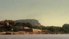 The ruins of a hindu temple seen across a river. Stock Footage