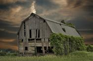 Stock Photo of dilapidated barn at sunset