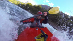 Unique Point of View of Whitewater kayaker on a class IV river Stock Footage