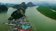 Aerial view tourist vessels leaving Ko Panyee, Phang nga Bay, Thailand Stock Footage