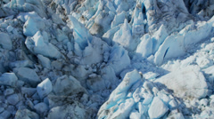 Aerial view of large ice glacier scared by dirt and debris, Alaska Stock Footage