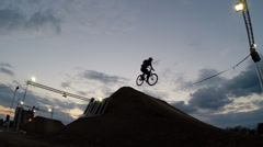 BMX rider making a bike jump Stock Footage