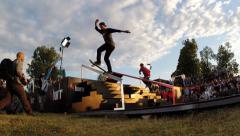 Skateboarder doing a slide trick Stock Footage