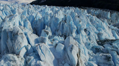 Aerial view ice glacier constantly moving under its own gravity, Alaska - stock footage