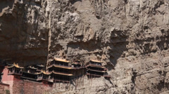 Hanging temple at datong china with tourists Stock Footage