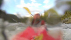 Slow motion unique Point of View of Whitewater kayaker on a class IV river Stock Footage