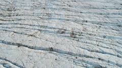 Aerial view glacier constantly moving under its own gravity, Alaska Stock Footage