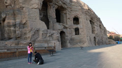 People visit the yungang grottoes at datong china Stock Footage