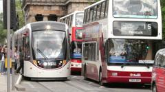 Tram at platform with traffic, princes street, edinburgh, scotland Stock Footage