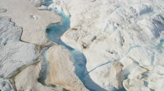 Aerial view glacial ice river of ice blue water Arctic region Stock Footage