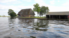 Dutch houses and gardens in Giethoorn, The Netherlands. Stock Footage