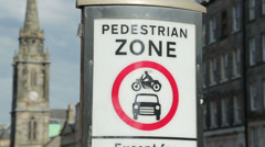 pedestrian zone sign in the royal mile, edinburgh, scotland - stock footage