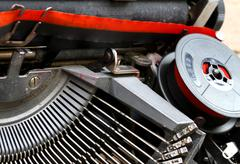 coil of red and black ribbon of an old typewriter 2 - stock photo