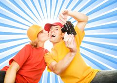 Stock Illustration of young couple photographing themselves