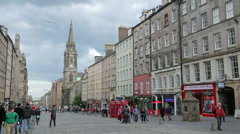 people walking along the royal mile, high street of edinburgh, scotland - stock footage