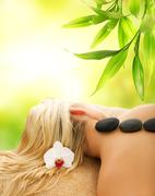 Stock Illustration of massage with volcanic hot stones