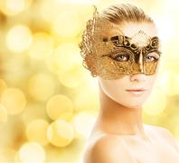 Beautiful young woman in carnival mask Piirros