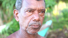Portrait of a fisherman on beach in Mirissa. Stock Footage