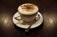 Cup of cappucino (toned in sepia) Stock Photos
