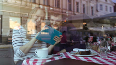 Happy young couple with tablet PC in a cafe Stock Footage