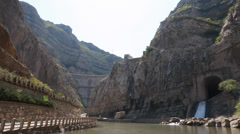Dam by the hanging temple in datong china with tourists Stock Footage