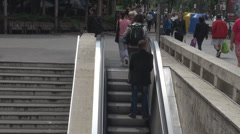 Commuters on escalators going out of subway station, crowded and busy big city - stock footage