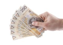 Polish money in hand. Clipping path included. - stock photo