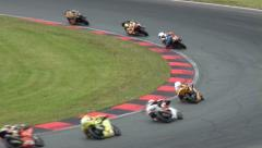 Motorbike and Superbike motorsports racing curve - stock footage