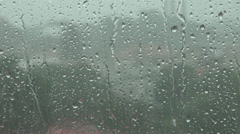 Close-up summer rain drops on window, rainy weather outside, powerful rain out Stock Footage