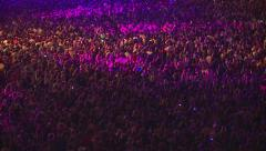 Huge crowd of fans waving their hands and applauded at a rock concert in Kiev. Stock Footage