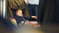 Little child sitting in massage chair Stock Footage