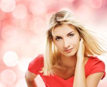 Beautiful blond woman over abstract background Stock Illustration
