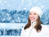 Stock Illustration of beautiful young woman in winter clothing outdoors