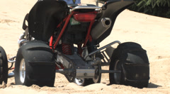 1440 Quad Spinning the Tires in the Sand Close Up - stock footage