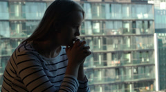 Lonely sad woman against modern city background Stock Footage