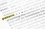 Stock Photo of The word patent highlighted in a dictionary
