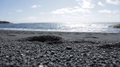 Black Sand Beach with little girl running pass Stock Footage