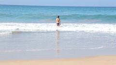 Woman getting into ocean in Mirissa. Stock Footage