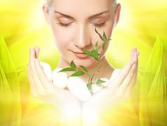 Beautiful young woman holding plant growing up through stones Stock Illustration