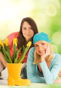 Beautiful teenagers with spring flowers over abstract blurred background Stock Illustration