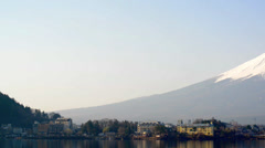 Mount Fuji rises above Lake Kawaguchi - stock footage