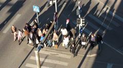 People walking across the road on zebra Stock Footage