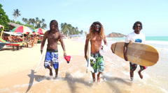 Three local surfers with boards and glasses and long hair in Mirissa. Stock Footage