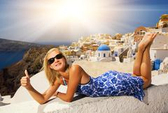 beautiful blond girl on santorini island (greece) - stock illustration