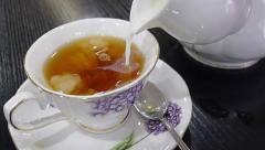 Making milk tea Stock Footage