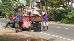 Local garbage collectors and truck in Weligama, Sri Lanka. - stock footage