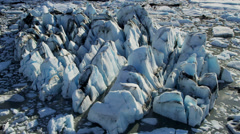 Aerial view ice glacier moving under its own gravity, Alaska - stock footage