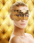 Stock Illustration of beautiful woman in carnival mask over abstract background