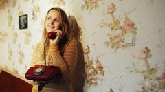 Happy young woman receving a call at home - stock footage