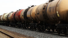 Freight train with tank cars passing by Stock Footage
